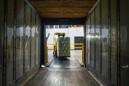 Inventory and forklift in shipping container