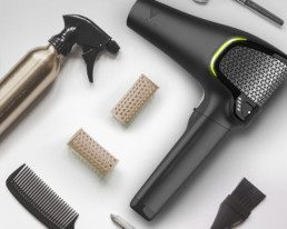 black volo hairdryer with other hairstyling products