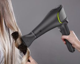 black volo hairdryer curling blonde hair with brush